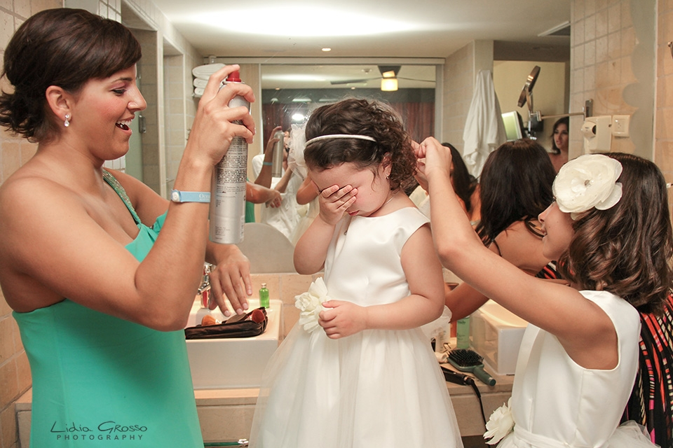 Flower girl getting raedy Iberostar cancun wedding photographer