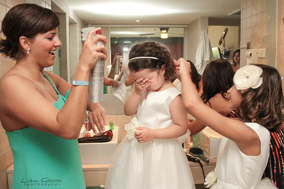 Flower girl getting raedy Iberostar cancun wedding photographer