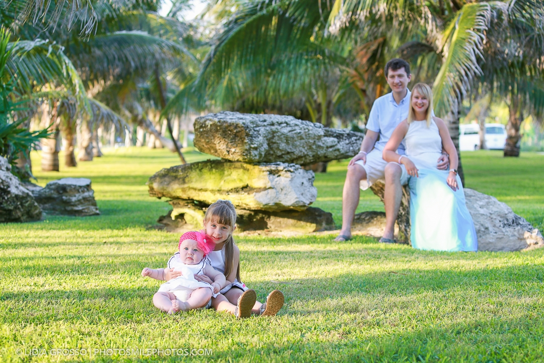 Family portrait grass and palm trees photos